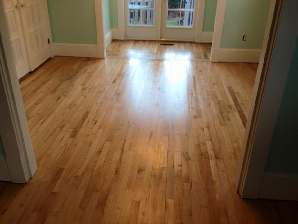 The hardwood floor was completely sanded and refinished with a gorgeous satin finish